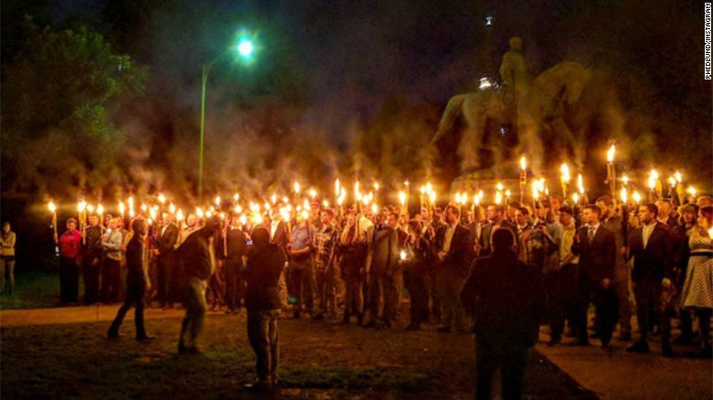 "White Supremacists Carry Torches, Nazi, And Confederate Flags Chanting ""Heil Tump!"""