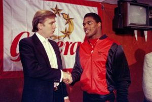 Mandatory Credit: Photo by Dave Pickoff/AP/REX/Shutterstock (5926524a) Donald Trump Then-New Jersey Generals owner Donald Trump, left, shakes hands with Herschel Walker at a press conference in New York, after agreeing on a 4-year contract. Retired NFL player Herschel Walker says he's being dropped from speaking engagements because of his relationship with Donald Trump GOP 2016 Trump Profile, New York, USA